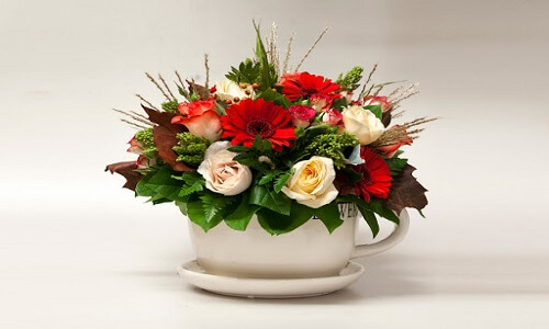 teacup and saucer flower arrangement